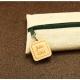 Trousse en jute/coton et zip breloque carré