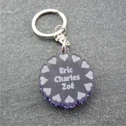 Porte clés fleur de coeurs gris